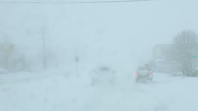 ws pov driving in snow storm / richmond, virginia, usa - car point of view stock videos and b-roll footage