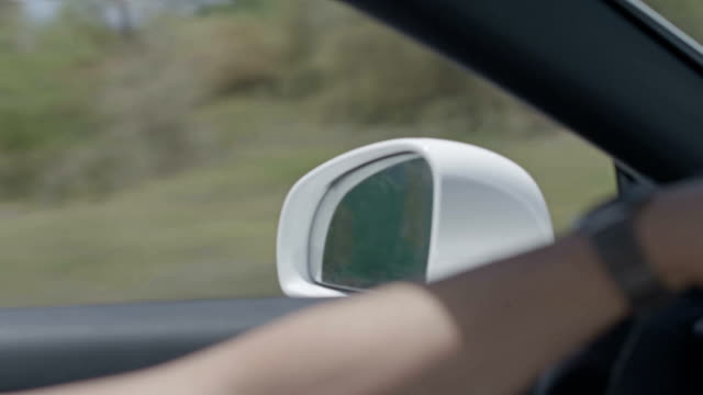 Driving In The Car. Close Up In Slow Motion