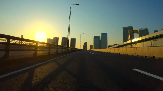 driving in the city at dusk - motorway stock videos & royalty-free footage