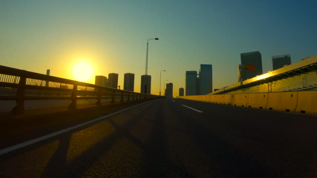 driving in the city at dusk - plusphoto stock videos & royalty-free footage