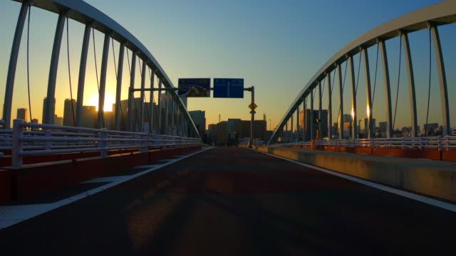 stockvideo's en b-roll-footage met rijden in de stad in de schemering - landvoertuig