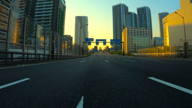driving in the city at dusk - thoroughfare stock videos & royalty-free footage