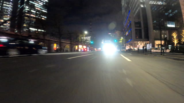 driving in the city at night / rear view - behind stock videos & royalty-free footage