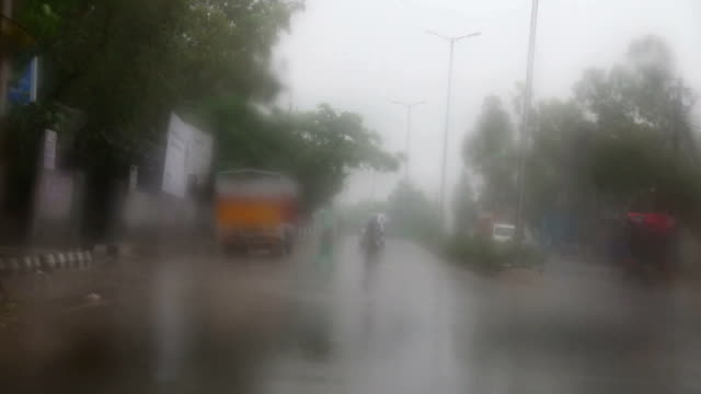 Driving in the City During Rainy Season, view from inside