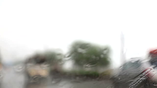 driving in the city during rainy season, view from inside - saving up for a rainy day stock videos and b-roll footage