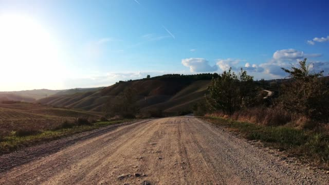 driving in the countryside road in tuscany - off road racing stock videos & royalty-free footage
