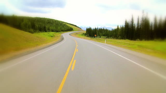 hd slow-motion: driving in the countryside - country road stock videos & royalty-free footage