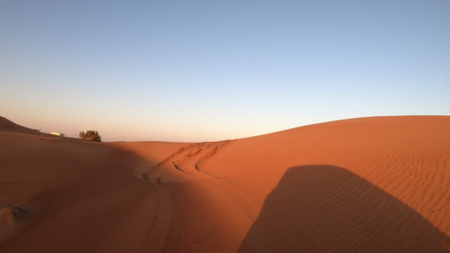 driving in the desert in the united arab emirates at sunset - aboard stock videos & royalty-free footage