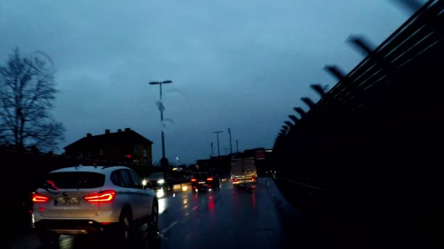 driving in the rain at night on highway through munich, germany - high point video stock e b–roll