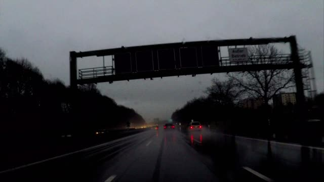 driving in the rain at night through dark forest on highway near munich, germany - high point video stock e b–roll