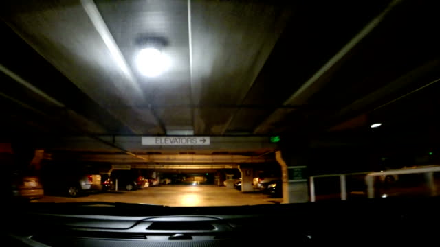 driving in the rain from street to parking lot - parking stock videos and b-roll footage