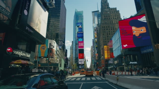 driving in times square, new york city - car point of view stock videos and b-roll footage