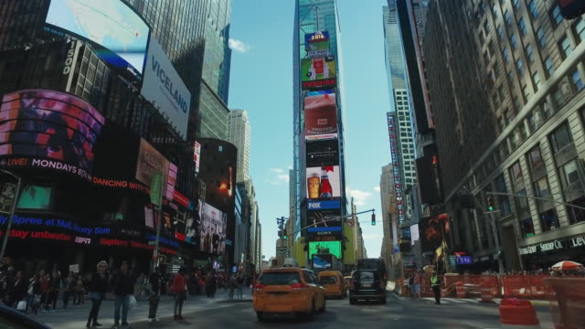 driving in times square, new york city - manhattan new york city stock videos & royalty-free footage