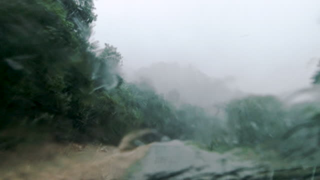 driving in torrential rain storm first person point of view - country road stock videos & royalty-free footage