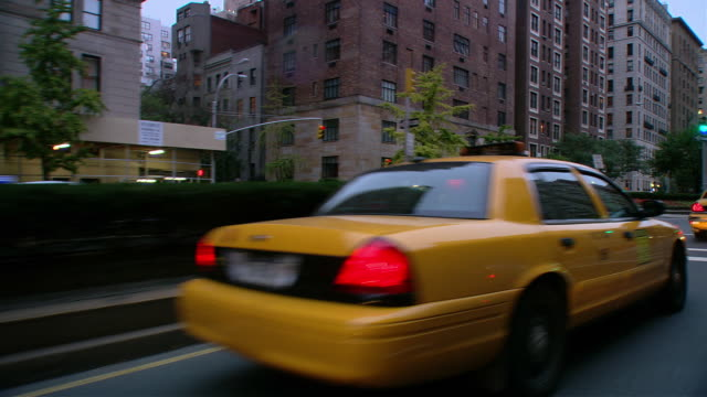 ds driving in traffic on park avenue past mid-rise buildings / new york city, new york, united states - median nerve stock videos & royalty-free footage