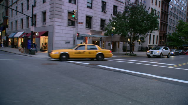stockvideo's en b-roll-footage met ds driving in traffic through an upper east side street of mid-rise buildings / new york city, new york, united states - b roll