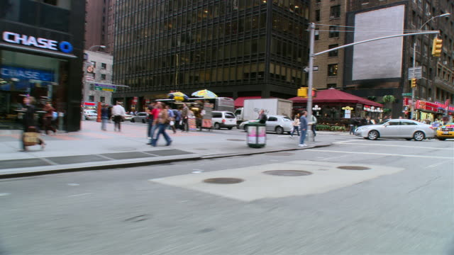 DS Driving in traffic through Midtown retail district, cruising past storefronts / New York City, New York, United States