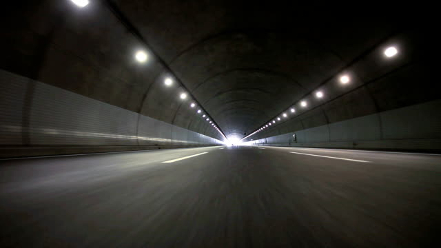 stockvideo's en b-roll-footage met driving in tunnel - rear view - tunnel