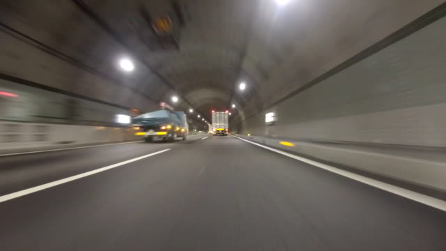 driving in tunnel -super low angle- - land vehicle stock videos & royalty-free footage