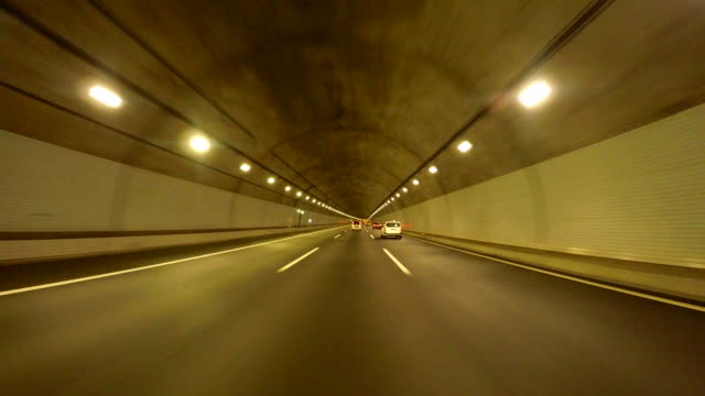 driving in tunnel -super low angle- - concrete stock videos & royalty-free footage