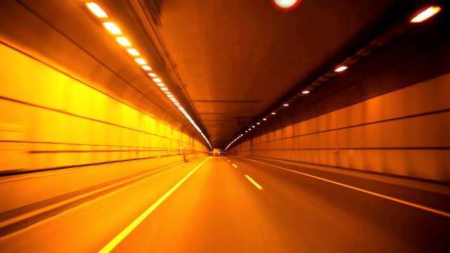 driving in tunnel - exit sign stock videos & royalty-free footage