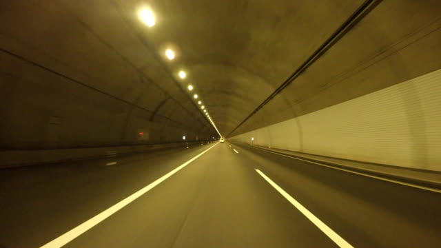 driving in tunnel - distant stock videos & royalty-free footage