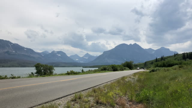 driving in us glacier national park - glacier national park us stock videos and b-roll footage