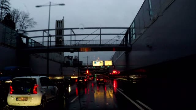 driving into a traffic tunnel and underpass at night, munich, germany - high point video stock e b–roll