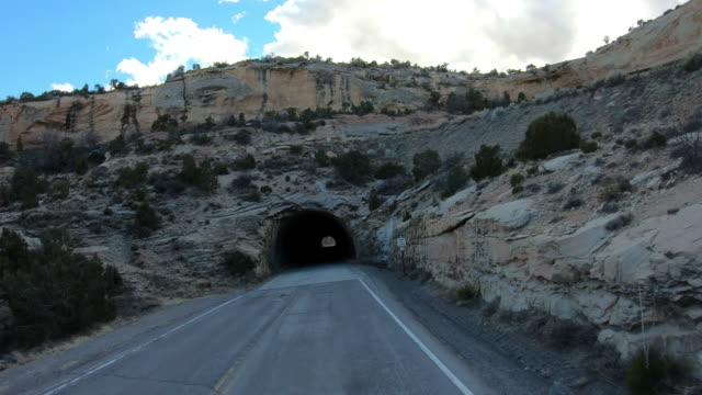 stockvideo's en b-roll-footage met driving into a tunnel, national park usa - red rocks