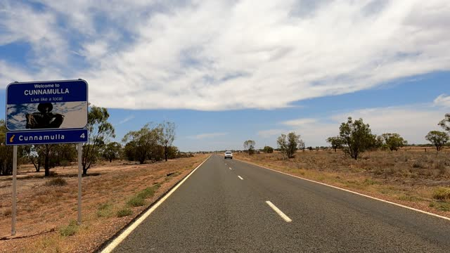 driving into country town, outback australia - queensland stock videos & royalty-free footage