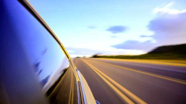 vídeos de stock, filmes e b-roll de condução para o pôr do sol - ensolarado