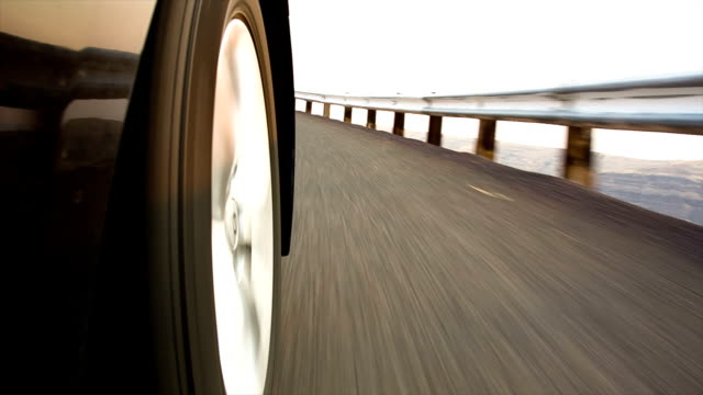 driving low angle shot - tire vehicle part stock videos and b-roll footage