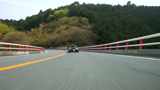 Driving mountain road ,Rear View