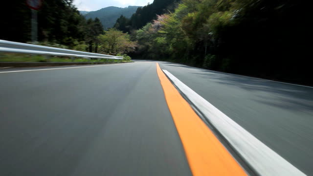 driving mountain road - curve stock videos and b-roll footage