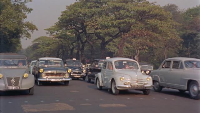 vidéos et rushes de ws rear pov driving near eiffel tower / paris, france - 1950
