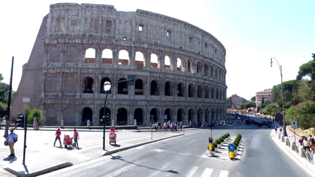 4k: driving near the colosseum in rome, italy - colosseum rome stock videos and b-roll footage
