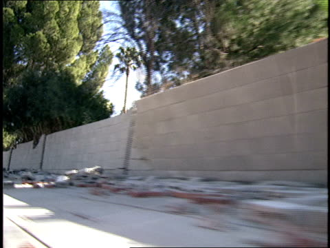 driving of past a wall damaged by northridge earthquake - northridge stock videos & royalty-free footage