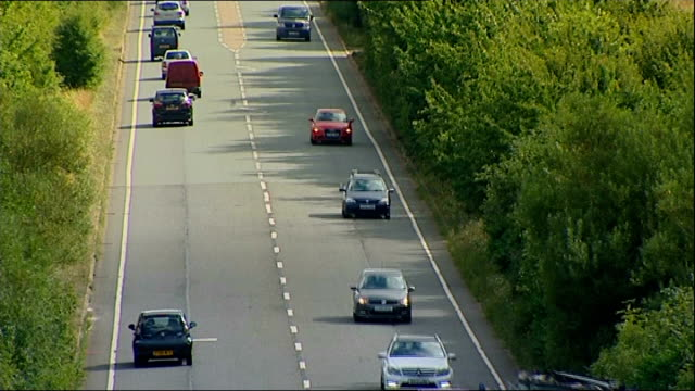 onthespot fines come into force ext high angle shots of traffic along a road overtaking - overtaking stock videos and b-roll footage