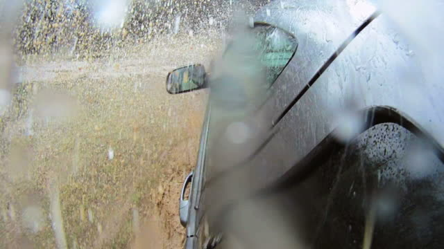 hd slow-motion: driving off-road - mud stock videos & royalty-free footage