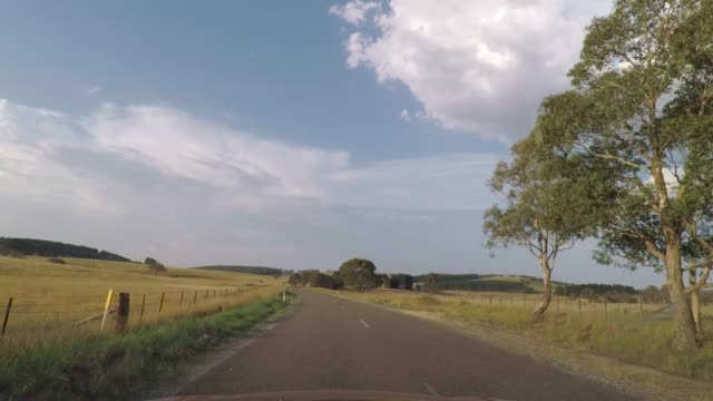 driving on a country road in rural new south wales, australia - rustic stock videos & royalty-free footage