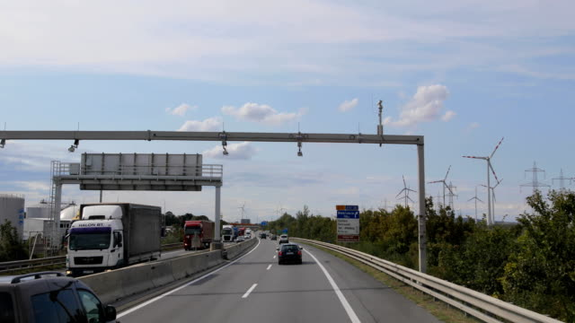 driving on a highway by the windmills - vienna austria stock videos & royalty-free footage