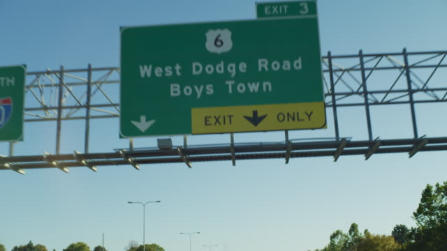 """pov driving on a highway expressway under a green sign """"south 680 highway 6 west dodge road boys town exit only."""" - only boys stock videos & royalty-free footage"""