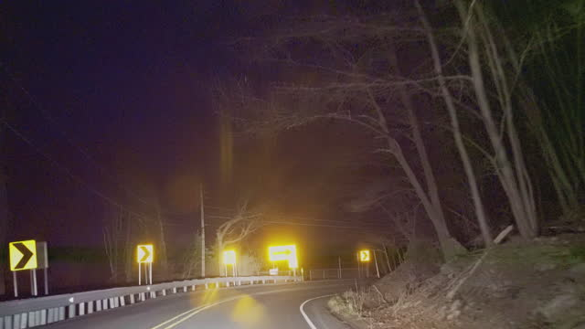 driving on a highway in a countryside, across a forest in mountains, in the night. - road sign stock videos & royalty-free footage