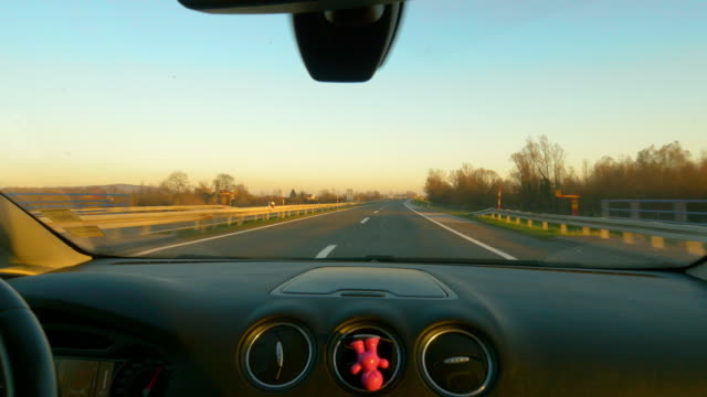 pov driving on a highway zagreb-belgrade at dawn - windshield stock videos & royalty-free footage