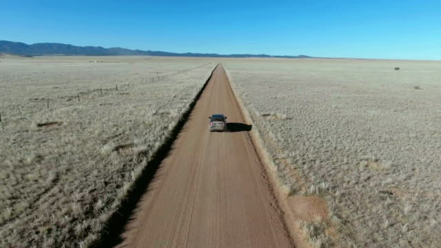 driving on a lonely desert road - drought stock videos and b-roll footage