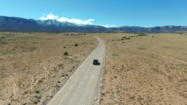 driving on a lonely desert - ranch stock videos & royalty-free footage