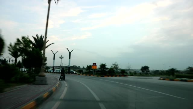 driving on a multilane road - punjab pakistan stock videos and b-roll footage