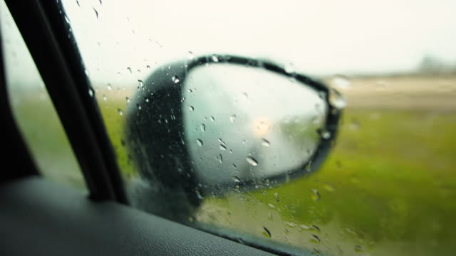 Driving on a rainy day- Right mirror POV