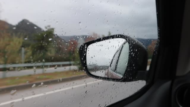 driving on a rainy day - wing mirror stock videos & royalty-free footage