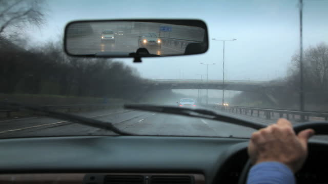 Driving on a rainy wet day with poor visibility and spray on a Motorway.